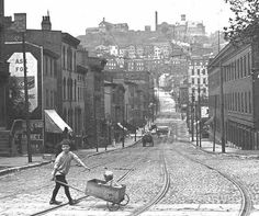 1900 Cincinnati, 5th St. with Rookwood Pottery & Mt. Adams Inclined Plane on the hilltop.