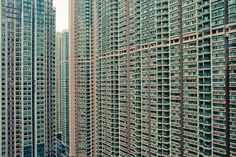 The impressive repetition of tall apartment buildings in 香港 Hong Kong. The exceptionally hard granite and excellent engineering have enabled forests of tall blocks like these in many urban districts.