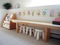 I like the idea of a long table with chairs against the wall in jaxsons playroom