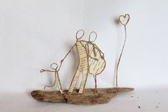 Wire, book page, driftwood, and mod podge sculptures
