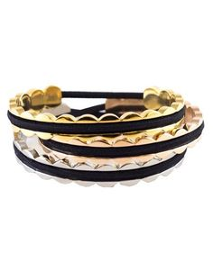 BelaBracelets Scalloped Hair Tie Bracelet Cuff | They're hanging from the chimney with care, it's time to fill them with these festive and inexpensive treats. See more great gifts for everyone on your list.