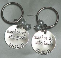 Two hand stamped sterling silver keychains - perfect for wedding gifts. $39.00, via Etsy.