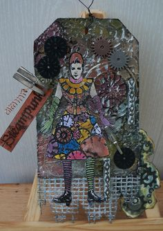Background is alu foil tape with gesso and alcoholinks, steampunk tag, made by Alie Hoogenboezem-de Vries