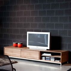 Teak Essential TV unit - raw, glass polished teak in all its beauty! Two sizes, drawer and open storage for media boxes.