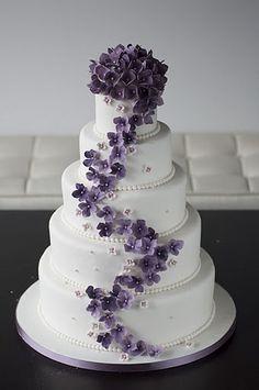 Purple Hydrangeas on a white cake.