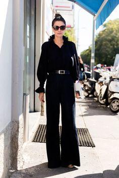 Leila Yavari in a Sonia Rykiel blouse, J Brand flares, Pierre Hardy wedges, and Celine sunglasses.