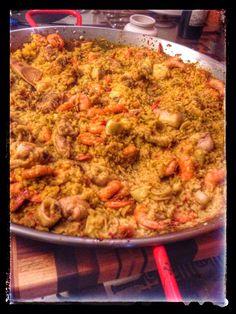 Spanish Paella with shrimp, chicken and calamari. Explosion of flavor.