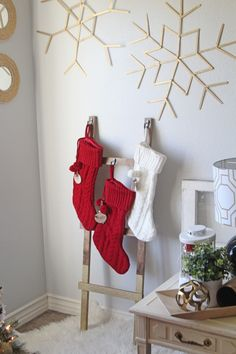 No mantel? No problem. This DIY ladder stocking holder is easy to make and provides a perfect to hang your Christmas stockings. Santa will approve!