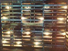 A buddy of ours came up with this for a wedding decoration idea. Brilliant! Using wooden pallets an clear lights. #DIYWEDDING.