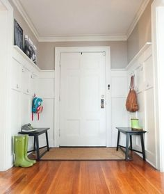 The Natos family spent less than $100 to add paneling to their entryway and mount a multitude of hooks at both adult and child level.