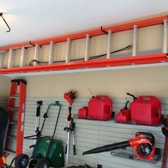 Traditional Garage And Shed Organization Design, Pictures, Remodel, Decor and Ideas - page 3 ladderstorage Garage Hanging Storage, Ladder Storage, Garden Tool Storage, Ladder Racks, Overhead Storage, Wall Storage, Shed Storage Solutions, Garage Workshop Organization, Organization Ideas