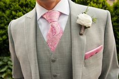 Groom wore a grey tuxedo with a pink patterned tie and white boutonniere. #groomfashion #greysuit Photography: Kelly Guenther Studio. Read More: http://www.insideweddings.com/weddings/penthouse-suite-wedding-in-new-york-citys-soho-neighborhood/507/