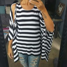 NWOT Michael Kors Striped Batwing Top Stunning black and white striped top with cold shoulder and batwing sleeves. Gold tone Michael Kors bar on each shoulder. 95% rayon 5% spandex. Ridiculously soft and fun! Michael Kors Tops