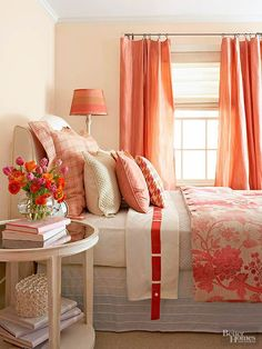 The warm color palette in this enchanting bedroom begins with the walls. Paint in a deep, dusty taupe with whispers of rose creates a feeling of intimacy, while salmon-color silk taffeta draperies define the window and add sheen. A floral duvet on the bed blushes in shades of pink that are echoed in the painted lampshade.