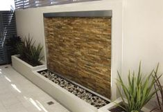 Whether in kit form or custom designed, a water feature is a must-have With a kit form water feature from Water Motion Energy (WME), having a stunning water feature in your home or garden Small Garden Landscape Design, Backyard Garden Design, Outdoor Wall Fountains, Outdoor Walls, Indoor Waterfall Wall, Gate Wall Design, Privacy Fence Designs, Backyard Water Feature, Water Walls