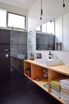 I like the the shower in this bathroom, though I'd like a bit lighter color. And with drawers rather than an open cabinet.