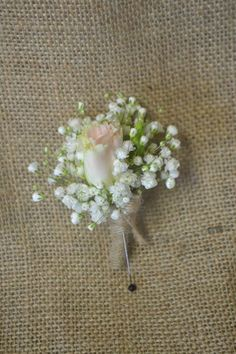 Rustic white lisianthus and baby's breath boutonniere. Fleurish Floral Designs