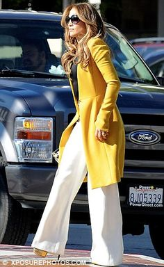 Keen as mustard! Yellow-clad J-Lo leads the way as the American Idol judges head…
