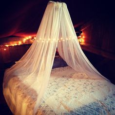 DIY bed canopy. Use sheer curtains, twinkle lights and an embroidering circle.