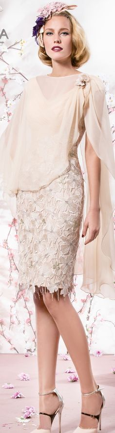 Elegant mother of the bride short dresses can have a chiffon wrap like this one.  This #fashion piece has an embellished skirt.  The wrap covers the upper portion of the arms and neckline. Let us recreate a look like this for your formal special occasion.  Get pricing on custom designs for #weddings and replicas of haute couture mother of the bride dresses at www.dariuscordell.com