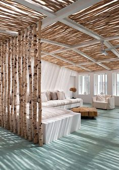 Contemporary sunroom with a beachy vibe and natural birch ceiling and partition [Design: Vera Lachia]