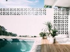 The Block's Kyal and Kara Demmrich sell Long Jetty home for staggering profit Backyard Pool Landscaping, Backyard Pool Designs, Swimming Pools Backyard, Airbnb Palm Springs, Breeze Block Wall, Palm Springs Style, Queenslander, Merida, Fence