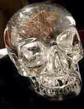 The Mitchell-Hedges crystal skull. This is a famous 10-pound crystal skull, with a hinged jaw, much like a real skull. New Agers believe it is 1 of 13 crystal skulls that ancient knowledge was downloaded into, like a computer. Because stones can hold energy, they believe this is possible. An English archeologist found the Skull under a Mayan ruin. They say the skull has been privately demonstrated to talk and give prophecies.