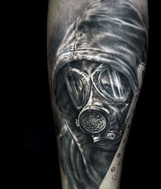 Incredible Shading Male Gas Mask Tattoo On Back Of Leg Calf