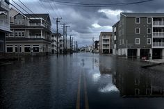 Water floods Landis Avenue in Sea Isle Tuesday afternoon. Hurricane Sandy hits New Jersey. Photo by (Aristide Economopoulos/The Star-Ledger) Water Flood, Sea Isle City, Tuesday Afternoon, Hurricane Sandy, Cape May, My Happy Place, New Jersey, Great Places, October