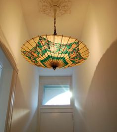 Rice Paper Parasol Light Fixture    omg I need to do this!! too bad I don't have high ceilings