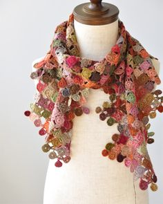 I must learn to crochet.   Found this picture  of a scarf created by Sophie Digard  and I am in LOVE. (Thanks, Pinterest ! You did it again....