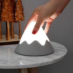 A portable little night light in the shape of Mount Fuji with a soft silicone snowcap that illuminates with a soft white light when squeezed or tapped. Best Baby Night Light, Boys Night Light, Baby Boy Rooms, Baby Room, Night Lamps, Night Lights, Snow Night, Whimsical Nursery, Mountain Decor