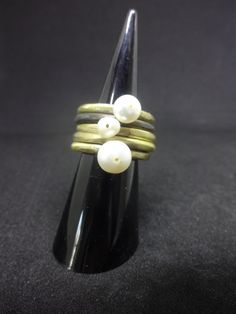 brass multi-ring by flora lampadinou...