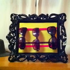 Sunglasses holder (frame, paper and ribbons) pretty and organized :)