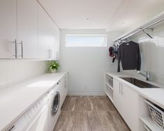 laundry room - hanging bar, big sink, lots of room to fold and store