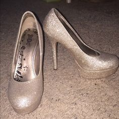 Gold sparkle heels. Worn a handful of times, mostly prom or formal gatherings. No scratches or bald spots. Excellent condition. 4.5 inch heel, so not too tall. Shoes Heels