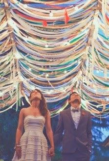 Ribbon/fabric strips hanging from trees, as backdrop elements (maybe more subtle palette?)