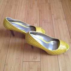 Charolette Russe yellow snake skin shoes Very gently used; worn once. Charolette Russe yellow snake skin shoe. Size 9 Charlotte Russe Shoes