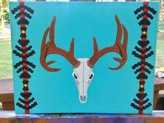 Stretched canvas, deer skull