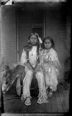 "thebigkelu: ""Two Children of Ongotoya (Solitary Traveler) Bow, Jr, Kiowa, in Native Dress near Brick Building - Mooney - 1892 """
