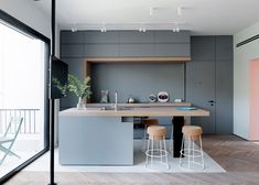 Interior designer Maayan Zusman and architect Amir Navon designed bespoke carpentry with hidden storage space for a 60-year-old apartment in Tel Aviv.
