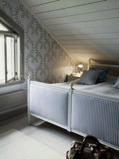 check upholstered gustavian beds, tucked under the eaves