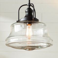 Features:  -Number of lights: 1.  Shade Material: -Glass.  Shade Color: -Clear.  Number of Lights: -1.  Product Type: -Schoolhouse pendant.  Material: -Glass. Dimensions:  Fixture Height - Top to Bott