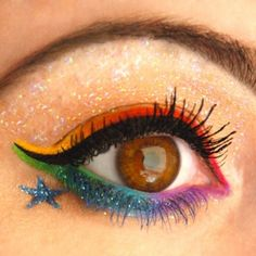 Rainbow glitter: | 26 Ways To Make Glitter Your New Smokey Eye......that be cool for abri party @Brittany Horton Horton Ortego
