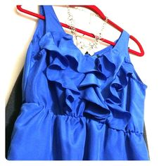 PRICE REDUCEDBlue ruffled sleeveless blouse Zinga blue ruffled v-neck sleeveless blouse, size: large, gently used and in excellent condition. Make me an offer. Must sell. Zinga Tops Blouses