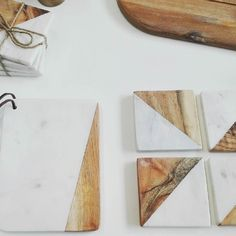 Loving these lovely marble/wood combinations! #marble #wood #geometric #coasters #cuttingboard #scandinavian #scandinaviandesign #newstuff #justarrived #square #triangle #natural #materials #livinglounge