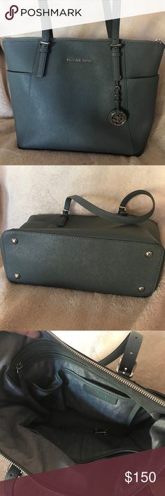 """🌟Jetsetter slate Michael Kors Purse 🌟 Excellent condition Purse! Only used once and decided it's not my style. My loss your gain! This is beautiful dark slate bag with silver accents and full zipper top. Lots of room inside the bag too!  Measures 11""""L by 10""""H by 4.5 W. This also has adjustable shoulder straps, on the middle hole it's measures a 9.5"""" drop. Michael Kors Bags Totes"""