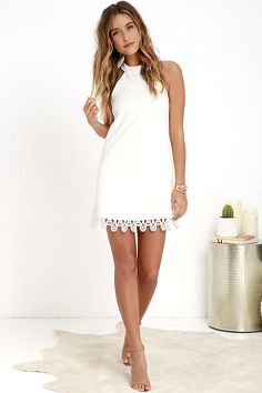 It's the perfect day to spoil yourself with the Greatest Gift Ivory Lace Dress! Halter neckline fastens with two hidden hook-and-eye closures behind the neck, that lead into unique, scalloped lace back straps. Darted, stretchy woven bodice has a trapeze silhouette and lace hem. Hidden back zipper.