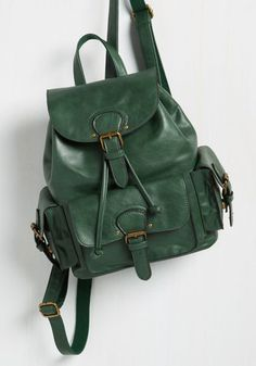 With the straps of this dark green backpack situated snugly atop your shoulders for the morning commute, you hold its gold hardware in your hands and relish in its chic convenience. Bedecked in buckles and outfitted with plenty of pockets, this faux-leather bag is a travel companion you'll always appreciate!