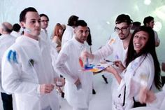 Continuing the color paint party...The invitation instructed guests to wear all white, with the note that protective gear would be provided. At the event, guests could don white coats to prevent paint from splashing on their outfits.